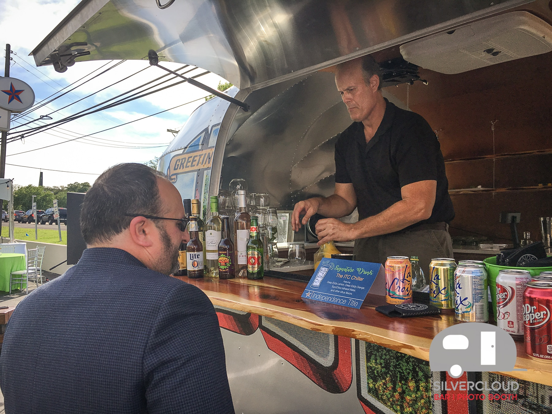 Silvercloud bartenders serving guests out of the Silvercloud Airstream Bar