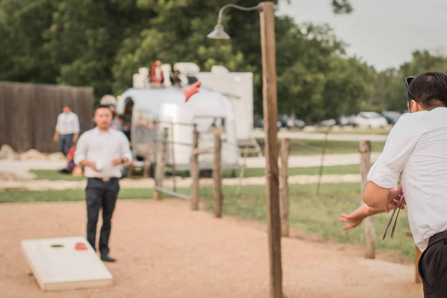 Silvercloud Airstream Photo Booth with wedding games on the lawn